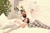Happy Fatherhood. Man Bearded Hipster With Childish Hairstyle Colorful Ponytails And Daughter In Paj poster