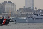 HOBOKEN, NJ - MAY 23: FNS Pohjanmaa (Finland) and USCGC Willow (WLB 202) pass on the Hudson River du