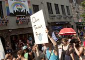NEW YORK - JUNE 22: Supporters march past the legendary Stonewall Inn, known as the birthplace of th