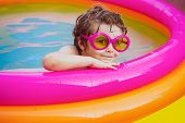 Summer Holidays And Vacation Concept. Kids Learn To Swim. Enjoying In Swimming Pool. Boy Happy Swimm poster