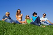Group Of Teens Relaxing