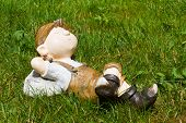 stock photo of hobgoblin  - Young boy slept in the green grass - JPG