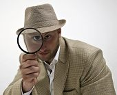 Spying Man With Magnifying Glass