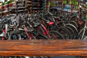 Mockup. Image Of Sport Store With Bike. Defocused, Blurred Image. In The Foreground Is The Top Of A  poster