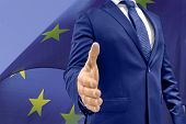 European Politician Or Business Man Open Hand Ready To Seal A Deal, Shaking Hands, Eu Flag Brexit De poster