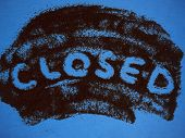 Word Closed Hand Written On Roast Ground Coffee On A Blue Background Top View. Can Be Used As Creati poster
