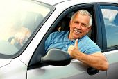 picture of car key  - Smiling happy elderly man in the new car - JPG