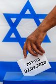Israeli Man Putting A Ballot In A Ballot Box On Election Day. Close Up Of Hand With White Votes Pape poster
