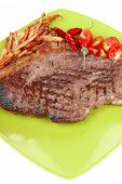main course : grill beef steak with potato chips and fresh cherry tomato , dry red hot chili peppers