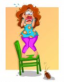 picture of hysterics  - scared woman standing on a chair and screaming because of a scary cockroach - JPG
