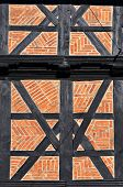 Wall of old medieval half-timber house in the historical center of Goslar, Germany. poster