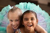 stock photo of bff  - Two little ballet students hugging each other - JPG