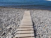 Wooden Path To The Sea. Flooring Of Planks On The Path To The Sea. poster