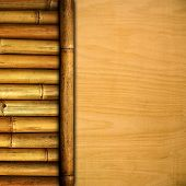 stock photo of peace-pipe  - wooden board with bamboo - JPG