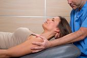 cervical stretching therapy with therapist doctor hands in woman neck