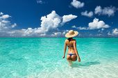 stock photo of thong  - Woman in bikini at tropical beach - JPG