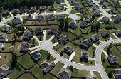 Aerial of modern suburban housing in the eastern United States.