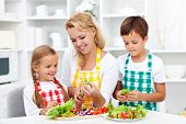 stock photo of apron  - Salad time with the kids in the kitchen  - JPG