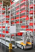 foto of shelving unit  - Work assistance vehicle in high shelving warehouse