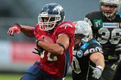 INNSBRUCK, AUSTRIA - JUNE 16 RB DJ Wolfe (#32 Broncos) runs with the ball on June 16, 2012 in Innsbr