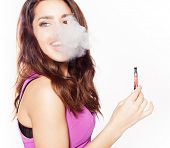 woman smoking e-fag wearing purple dress