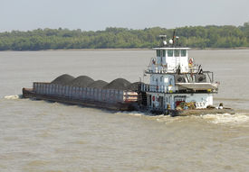 pic of coal barge  - Tugboat pushing a coal barge on the Mississippi River in New Orleans - JPG