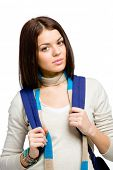 Half-length portrait of teenager wearing blue knapsack and colored scarf, isolated on white