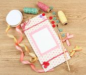 Beautiful hand made post card and scrapbooking elements, on wooden table