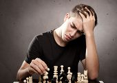 concentrated young man playing chess