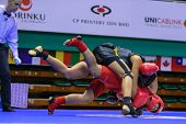 KUALA LUMPUR - NOV 03: Equador's Maria Quispe (red) fights Italy's Antonia Di Biase in the Women's '