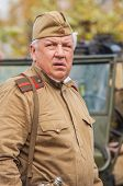 DNIPRODZERZHYNSK, UKRAINE - OCTOBER 26 :  Member of Historical reenactment in Soviet Army uniform af