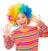 smiling little girl shows tongue and hands in clown wig isolated on white background