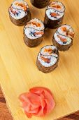 Japanese cuisine - sushi rolls with tobico and pancake