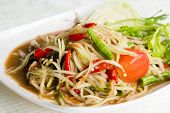 stock photo of green papaya salad  - Somtam Thai food hot and spicy papaya salad - JPG