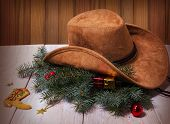 Cowboy Western Hat And Christmas Decoration On Wood Background