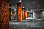 picture of underpass  - Columns of a subway station underpass low light - JPG