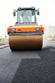 Heavy cibration roller compactor at asphalt pavement works for road repairing