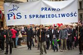 KRAKOW, POLAND - NOV 11: Unidentified participants celebrating National Independence Day, holds a poster
