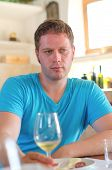 Man With Glass Of White Wine.