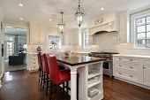 stock photo of wood  - Kitchen in luxury home with wood counter island - JPG