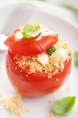 stuffed baked tomato with couscous and feta
