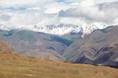 pic of semi-arid  - Landscape of arid Tien Shan mountains with snow peaks - JPG