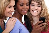 picture of threesome  - Three girls reading text message - JPG