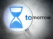 Time concept: Hourglass and Tomorrow with optical glass