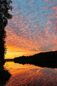 Dramatic sunset over the river in Karelia, the north of Russia
