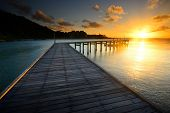 The Beautiful Wooden Pier With Sunrise At Rayong, Thailand