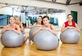 fitness, sport, training, gym and lifestyle concept - group of smiling people working out in pilates