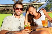 pic of hawaiian girl  - Woman drinking alcohol Mai Tai drink on Hawaii at beach club at sunset - JPG