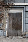 Old, Vintage, Dark, Wooden Door In A Brick Wall.