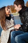 Happy Young Couple Outdoors At Sunny Autumn Day